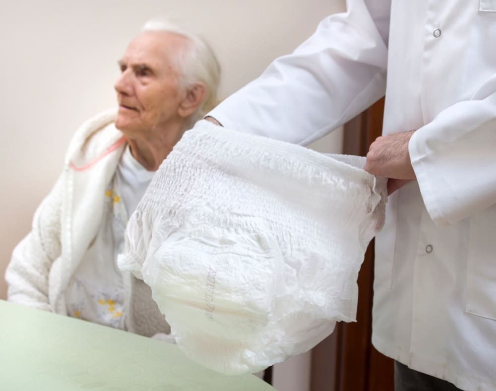 how do you manage incontinence in dementia patients