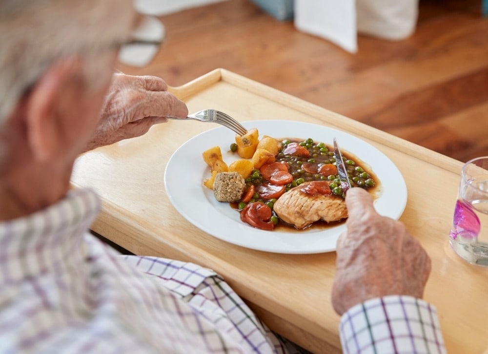 what causes a dementia patient to eat more